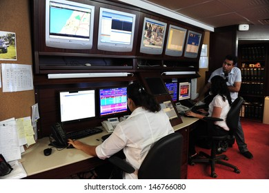 ASHKELON, ISR - JAN 18:CCTV security system operators on Jan 18 2009.According to a research, the average citizen is caught about 300 times a day on a CCTV camera.