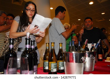 ASHKELON, ISR - MAR 24:Wine tasting at Ashkelon Wine festival on Mar 24 2008.Annual wine consumption among Israelis averages 4.6 liters of wine per person, similar to Hungary or Argentina
