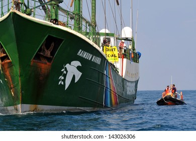 ASHKELON, ISR - SEP 03 2008:Israeli water police patrolling near the Rainbow Warrior during protest against Israel's plan to build a new electric power plant fueled by coal.