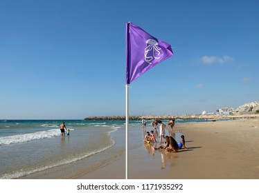 ASHKELON, ISRAEL - JUNE 24, 2017: Flag on the beach warning about the presence of jellyfish in the sea