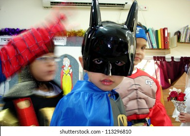 ASHKELON, ISRAEL - MARCH 02: Israeli child dressed up as batman costume during the Jewish holiday Purim in kindergarten in Ashkelon Israel.