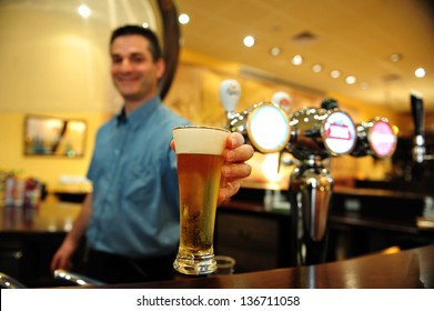 ASHKELON - JULY 27:Bartender pours a glass of beer on July 27 2009 in Ashkelon, Israel.Beer is the oldest alchoholic beverage and has been around since at least the ancient Sumerians of 2600 B.C