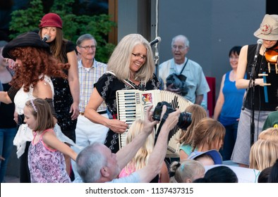 "ASHLAND, CA/U.S.A. - JUNE 22, 2018: Stephany Smith Pearson of the Bathtub Gin Serenaders performs for the free, outdoor ""Green Show,"" held six nights a week at the Oregon Shakespeare Festival."