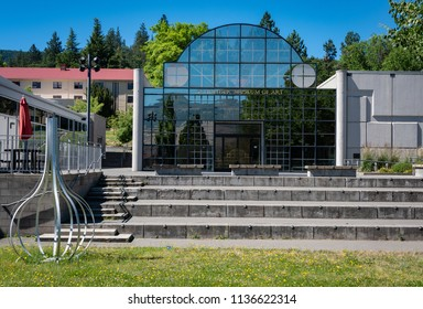ASHLAND, OR/U.S.A. - JUNE 23, 2018: A photo of the glass panel entrance to the Schneider Museum of Art, located on the Southern Oregon University campus.