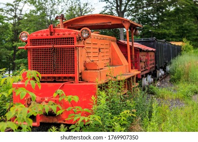 Ashland, PA, USA - June 27, 2011: An orange loco at the Pioneer Tunnel, which is a tourist attraction featuring a tour of a coal mine on mine cars and a separate narrow gauge steam train ride.