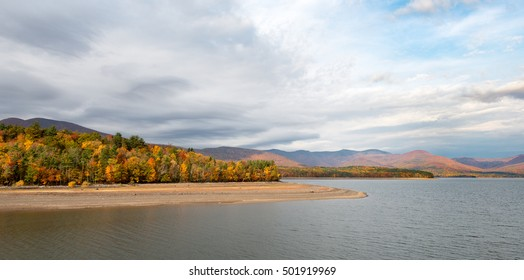 Ashokan Reservoir with Fall Colors and Dramatic Sky in the Mid-Hudson Valley. Reservoir is part of the NYC water supply, a destination for hikers and a home for Eagles.