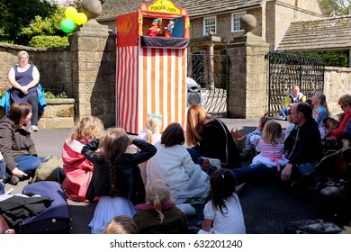 Ashover, Derbyshire, UK. May 01, 2017.  Children and parents enthralled with the Punch and Judy puppet show at the Annual Village Carnival at Ashover in Derbyshire.