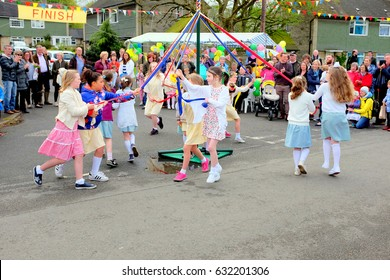 Ashover, Derbyshire, UK. May 01, 2017.  School children dancing the Maypole at the annual May day village Carnival at Ashover in Derbyshire.