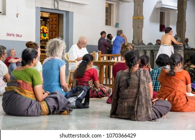 Ashram of Sri Ramana Maharshi, Tiruvannamalai, Tamil Nadu, India - March circa, 2018. Unidentified woman and man sitting on the floor of ashram, to meditate, spirituality.