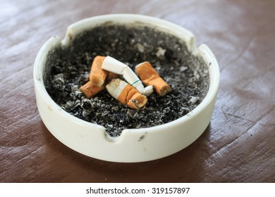 Ashtray with a cigarette butts.