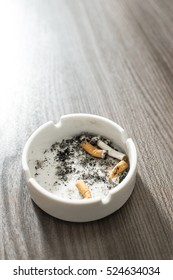 Ashtray with cigarette butts. Extinguished cigarettes. Close up