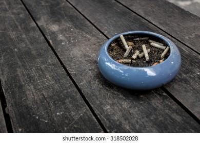 ashtray on wood table