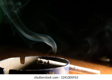 ashtray smoldering cigarette
