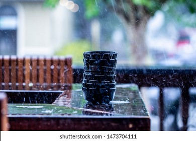 Ashtrays stacked up in the rain in color