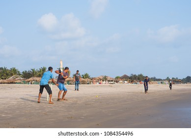 Ashvem Beach, Goa/India- May 1 2018: Local boys playing beach cricket in the evening at Little Ashvem Beach in Goa India