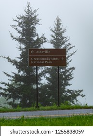 To Ashville or Great Smoky Mountains Sign on foggy day