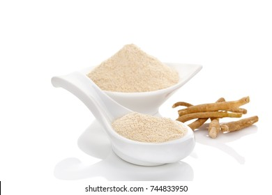 Ashwagandha powder and root in spoon and bowl isolated on white background.