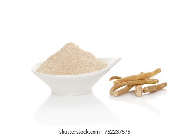 Ashwagandha powder with roots in bowl isolated on white background.