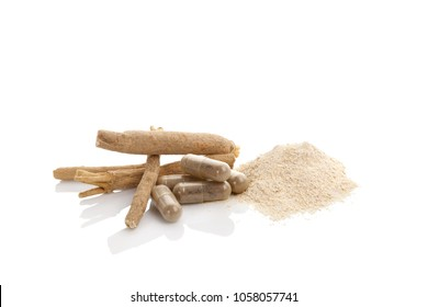 Ashwagandha powder with roots and gel capsules. Isolated on white. Superfood adaptogen. Natural remedy.