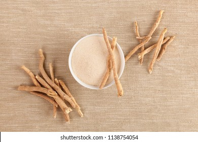 Ashwagandha root and powder supplement, top view.