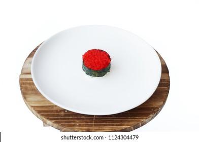 Asia - Asian eating food, Japanese food, Flying fish roe seaweed sushi on white plate  isolated on white background, close up
