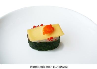 Asia - Asian eating food, Japanese food, Flying fish roe seaweed sushi with cheese isolated on white plate isolated on white background, close up