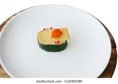 Asia - Asian eating food, Japanese food, Flying fish roe seaweed sushi with cheese on white plate isolated on white background, close up