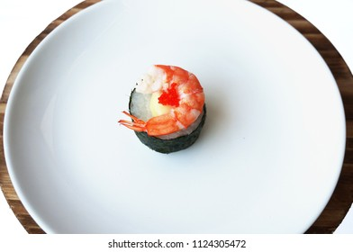 Asia - Asian eating food, Japanese food, sushi shrimp with seaweed and  flying fish roe isolated on white background, close up