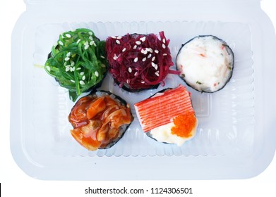 Asia - Asian eating food, Japanese food, sushi set on plate isolated on white background, close up