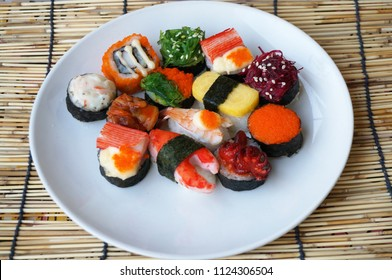 Asia - Asian eating food, Japanese food, sushi set on plate isolated on rattan curtain background, close up
