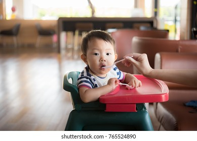Asia baby boy eating food at restaurant