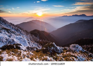Asia - Beautiful landscape of highest mountains reflect fantasy dramatic sunset sky in winter at Taroko National Park, Taiwan
