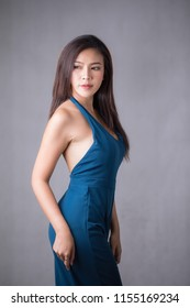 Asia beautiful woman wear blue dress pants. Standing in front of a white background.