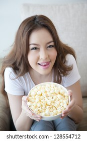 asia beautiful women with bowl of popcorn