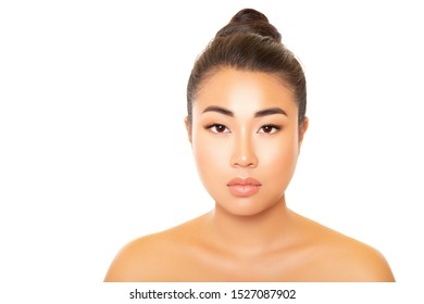 Asia Beauty. Beauty Portrait Brunette Asian Girl. Model looks directly at the camera, delicate smooth skin, beautiful light make-up, over a white background. plump lips. clean skin. - Image