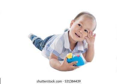 Asia boy with a camera, Boy joyful mood,white background.