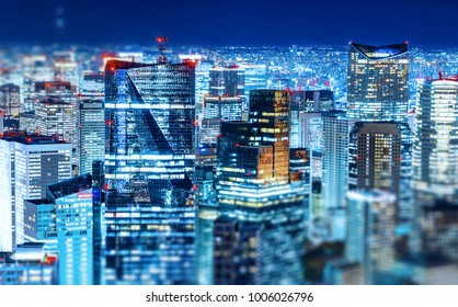 Asia Business concept for real estate & corporate construction - panoramic modern city skyline view with neon night in Roppongi Hill, Tokyo, Japan. Miniature Tilt-shift effect