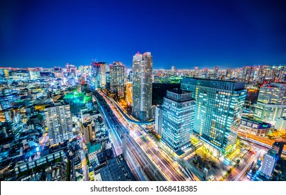 Asia business concept for real estate and corporate construction - panoramic urban city skyline aerial view under twilight sky and neon night with highway junction in hamamatsucho, tokyo, Japan