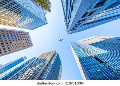 Asia Business concept for real estate and corporate construction - looking up view of panoramic modern city skyline with blue sky in tokyo, japan