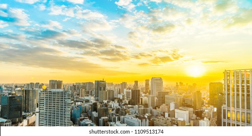 Asia Business concept for real estate and corporate construction - panoramic urban city skyline aerial view under twilight sky and golden sun in tokyo, Japan