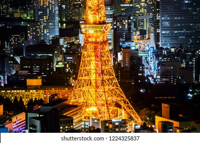 Asia Business concept for real estate & corporate construction - panoramic modern city skyline of Tokyo Tower with neon night in Roppongi Hill, Tokyo, Japan