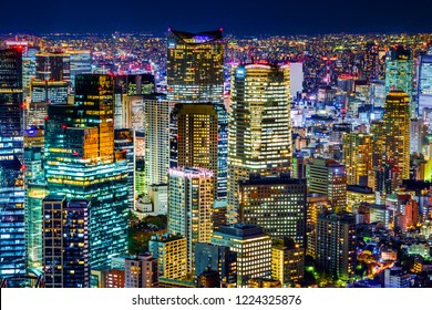 Asia Business concept for real estate & corporate construction - panoramic modern city skyline with neon night in Roppongi Hill, Tokyo, Japan