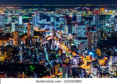 Asia Business concept for real estate & corporate construction - panoramic modern city skyline and metropolitan expressway junction with neon night in Roppongi Hill, Tokyo, Japan