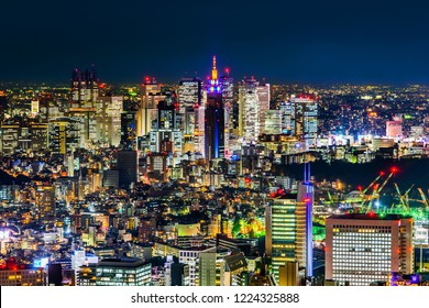 Asia Business concept for real estate & corporate construction - panoramic modern shinjuku city skyline with neon night in Roppongi Hill, Tokyo, Japan