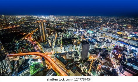 Asia Business concept for real estate & corporate construction - panoramic modern city skyline night view with expressway in Ikebukuro district, Tokyo, Japan