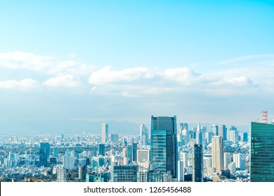 Asia Business concept for real estate and corporate construction - panoramic urban city skyline aerial view under bright blue sky and sun in Tokyo, Japan