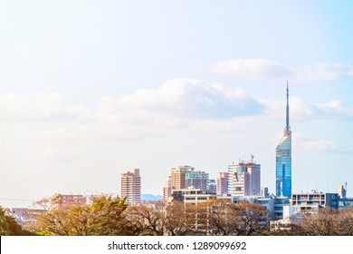 Asia Business concept for real estate and corporate construction - panoramic urban townscape aerial view with Fukuoka tower under bright blue sky and sun in Fukuoka Japan