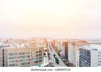 Asia Business concept for real estate and corporate construction - panoramic urban townscape aerial view with hakata port tower under bright blue sky and sun in Fukuoka Japan