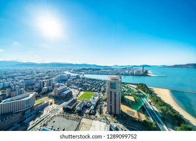 Asia Business concept for real estate and corporate construction - panoramic urban townscape aerial view of beach park under bright blue sky and sun in Fukuoka Japan