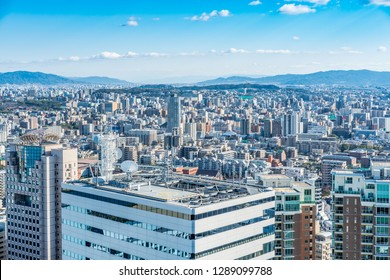 Asia Business concept for real estate and corporate construction - panoramic urban townscape aerial view under bright blue sky and sun in Fukuoka Japan